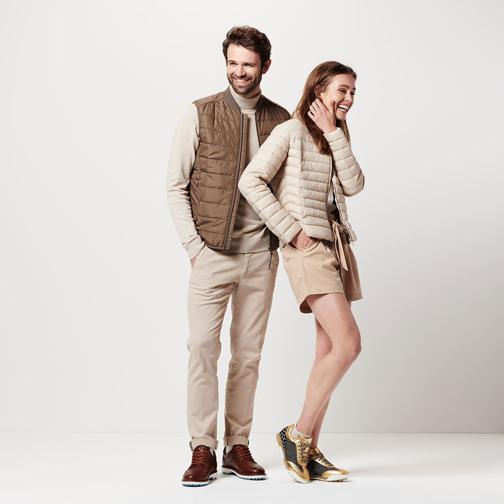 man and woman in duca del cosma golf shoes