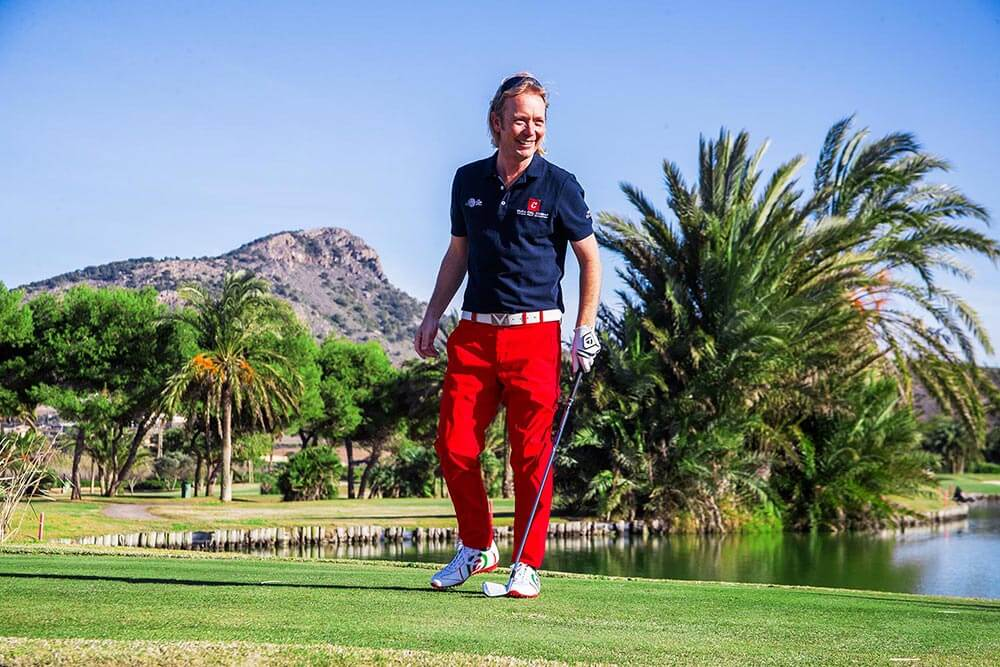 man wearing Duca del Cosma Kuba Italian Flag shoe on golf course
