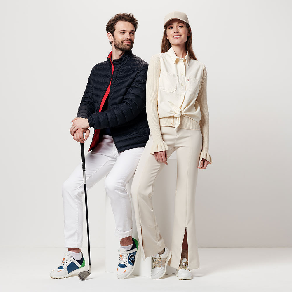 man and woman in Rebel and Vogue golf shoes