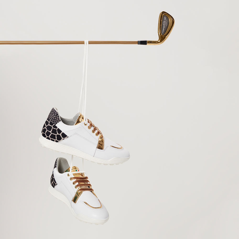 Vinci golf shoes hanging from golf clubs