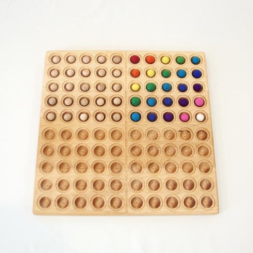 From Jennifer Hundred Board Maple/Walnut with Wool/Wood Balls