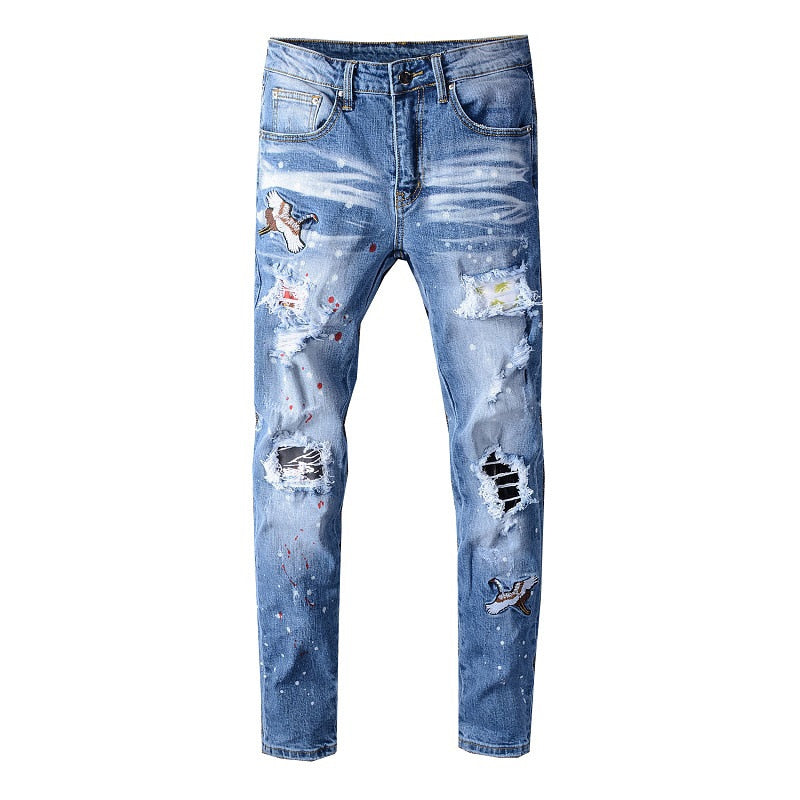 bird embroidered painted ripped jeans