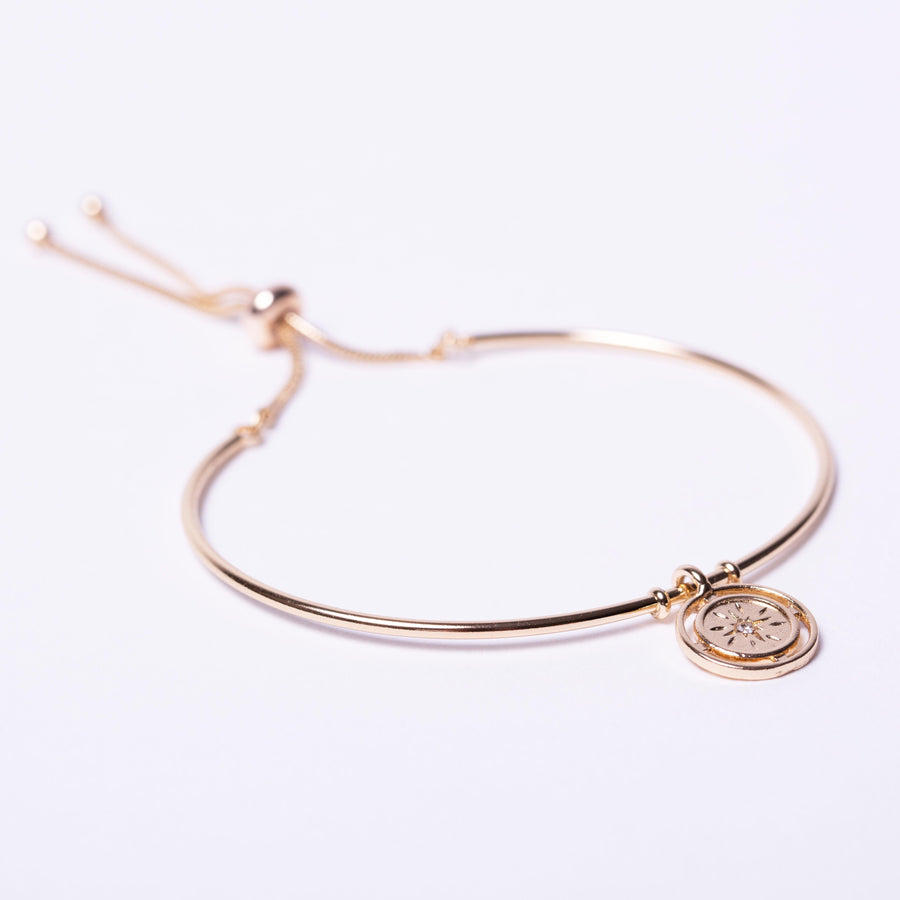 Gold coin cuff bracelet with adjuster