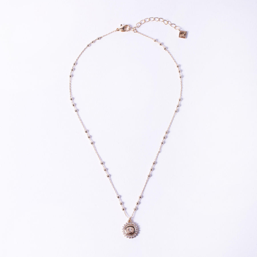 gold crystal pave medallion coin single necklace on station ball chain, jewellery layout