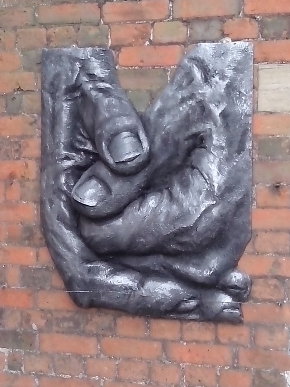 Hands sculpture for outdoor wall.