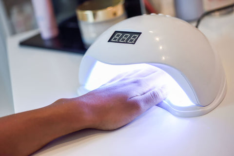 hand in uv cure lamp