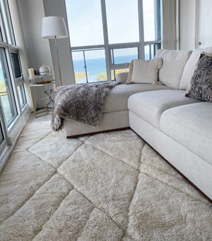 Moroccan rug Double Cream in its new home in Etobicoke Toronto Canada, 100% natural wool. This one is 7x9 but it can be made in any dimensions. Free worldwide shipping. Handmade in Morocco by women artisans.
