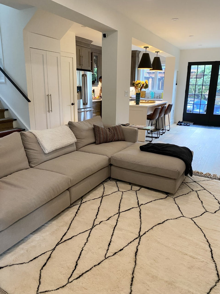 Authentic Moroccan rug in Toronto home in Canada. 100% pure wool with white background and black irregular lines. Reference: High Tide