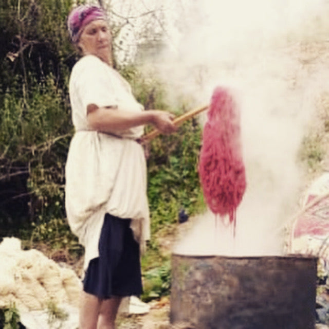 women weavers naturally dying wool to make Moroccan rugs