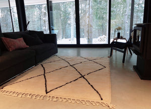 8x10 Moroccan rug with natural wool base and black diamond. Handmade in Morocco with 100% pure wool by Moroccan women artisans. Perfect for any cozy living room, bedroom or dining room. Based in Toronto, Canada, we ship worldwide for free. Our Anfa rug in its home in Ontario, Canada