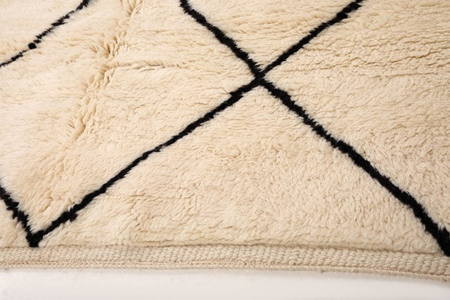 10x14 large Moroccan rug with natural wool base and black diamond. Handmade in Morocco with 100% pure wool by Moroccan women artisans. Perfect for any cozy living room, bedroom or dining room. Based in Toronto, Canada, we ship worldwide for free.