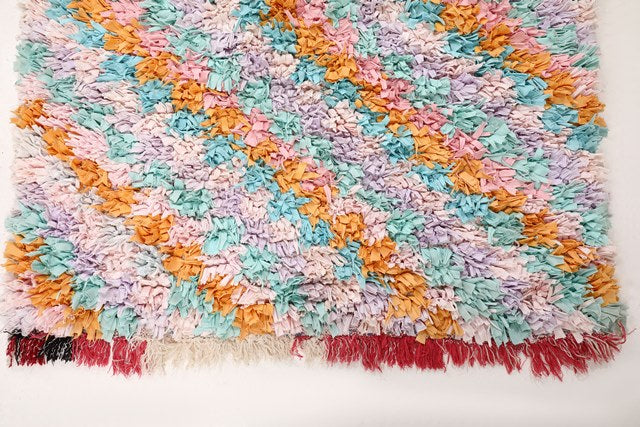 vintage Boucherouite Moroccan rug, made of recycled  clothes. Colorful rug with pastel tones: baby pink, blue and mustard. Can be used in a kids room, in a kitchen, in a bedroom, hallway and entrance