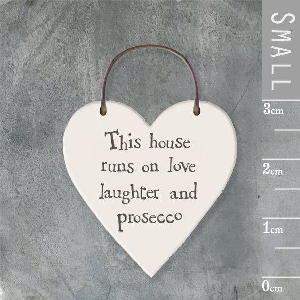 East of India - Small Wooden Heart-shaped Tag - 'This house runs on…'