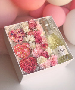 gift box - chocolate hearts, fresh flowers and prosecco
