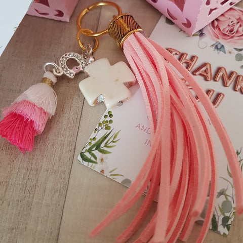 Baby pink keyring with cross and tassel