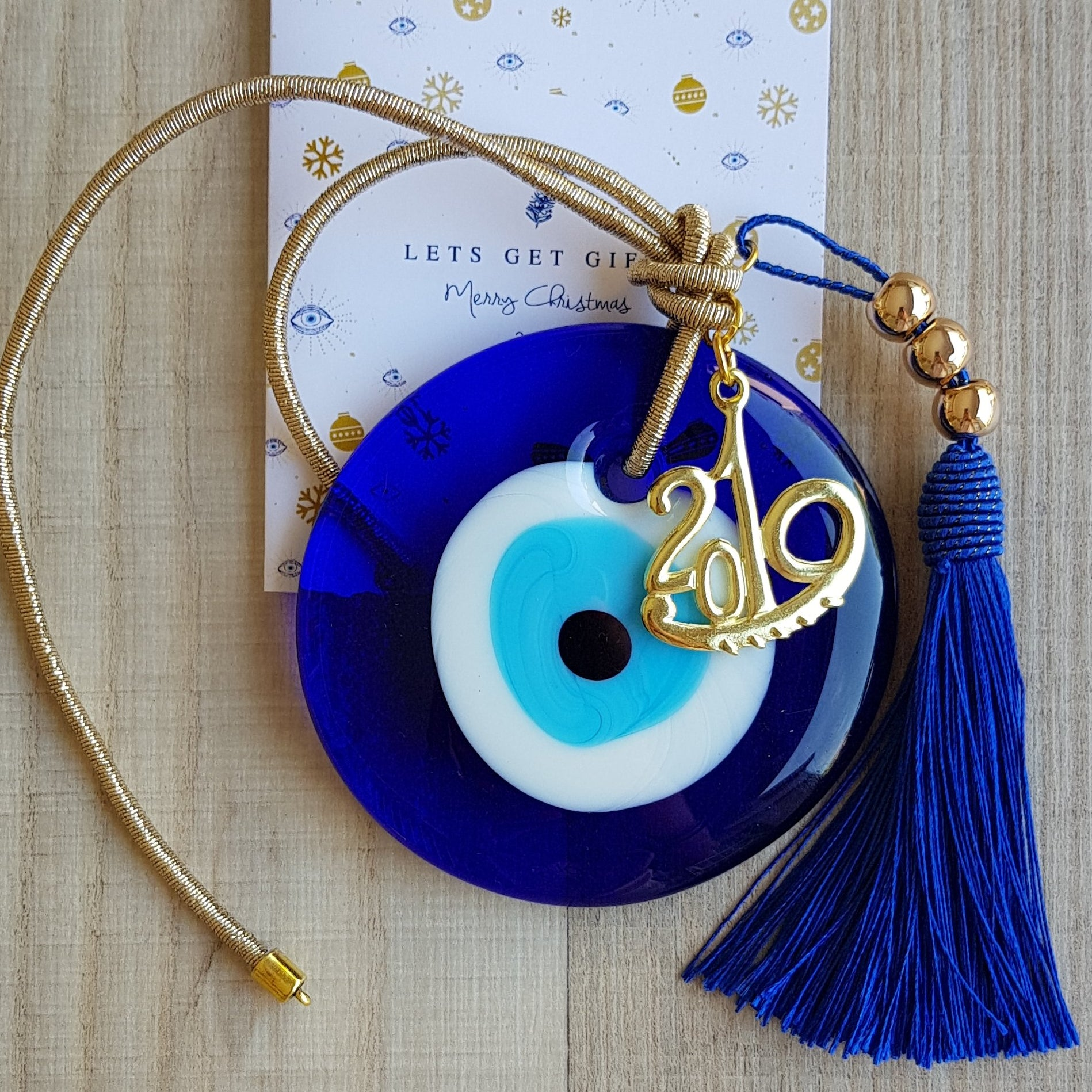 Gold mati wall hanging with blue tassel - Christmas collection