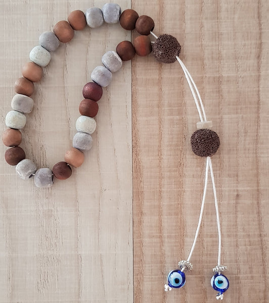 Brown and beige bead komboloi with mati beads