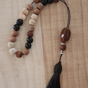 Black and brown wood bead komboloi with back tassel