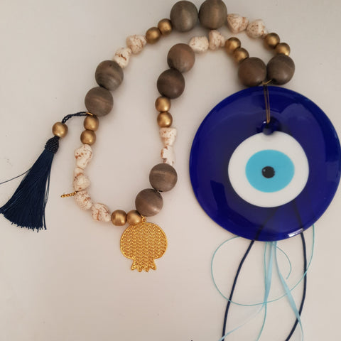 Large blue and gold mati wall hanging with gold pomegranate and tassel