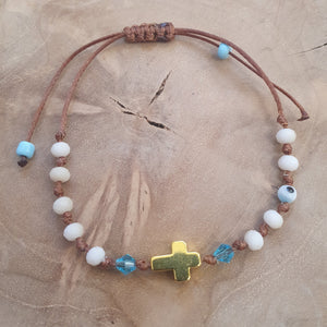 Ladies white stone and gold cross bracelet