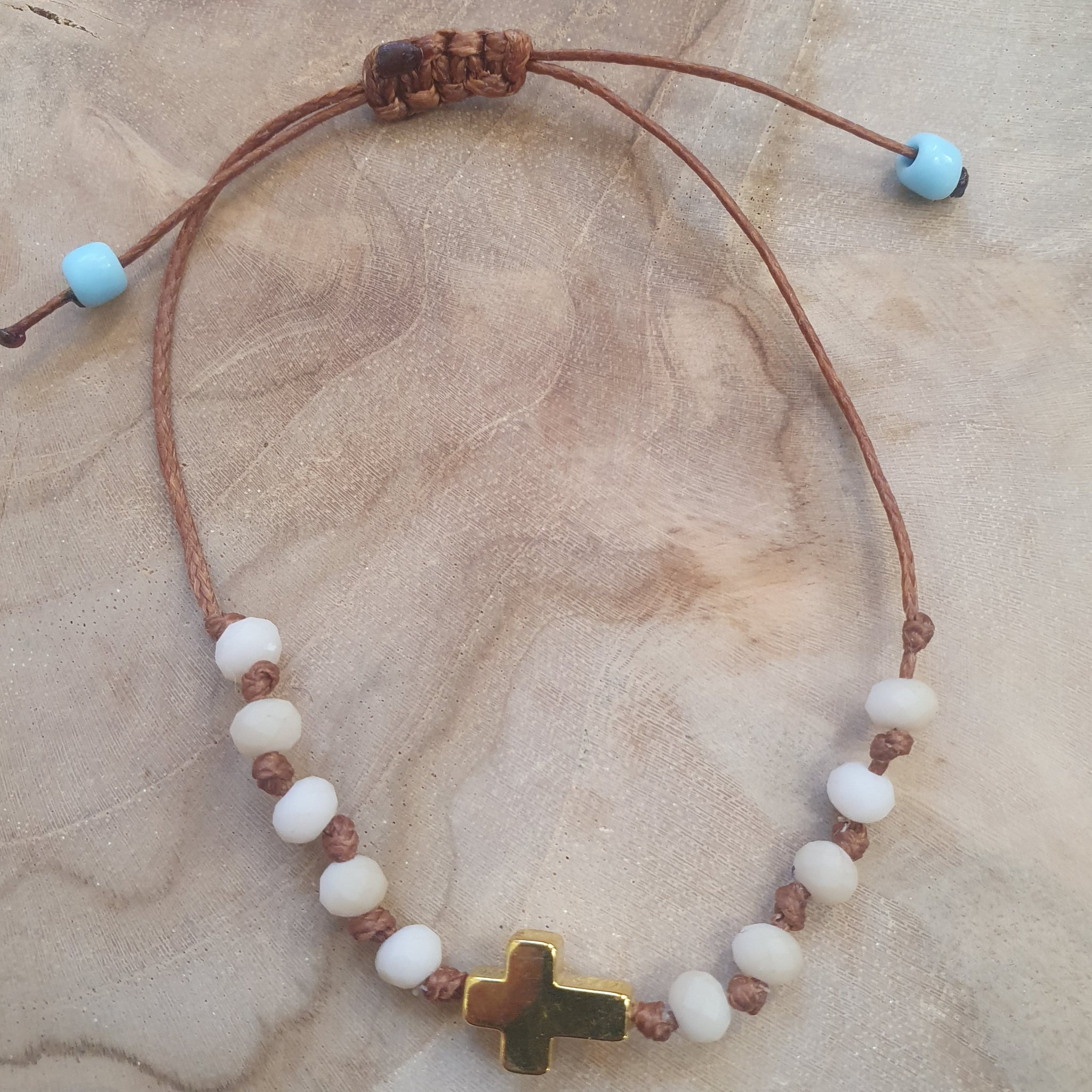 Ladies white stone with gold cross bracelet