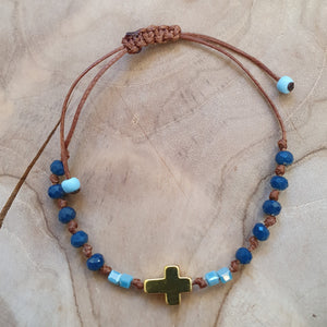Ladies mediterranean blue stone with gold cross bracelet