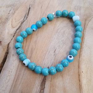 Ladies blue stone beads with evil eye
