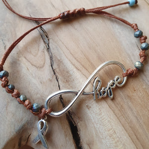 Hope bracelet with metallic silver stones and cancer ribbon