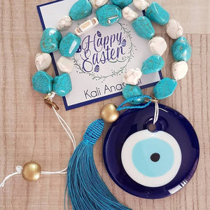 Beige and turquise blue mati wall hanging with turquise tassel and horse shoe - Easter collection