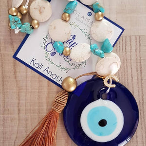 Gold, beige and turquise blue mati wall hanging with gold tassel and horse shoe - Easter collection