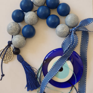 Blue mati wall hanging with large wooden beads, pomegranate and blue tassel