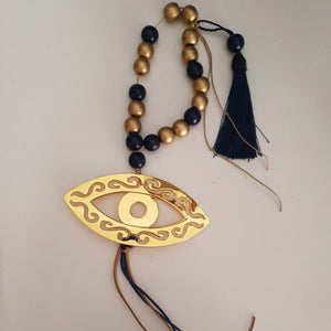 Gold and navy blue mati wall hanging with gold or navy tassel