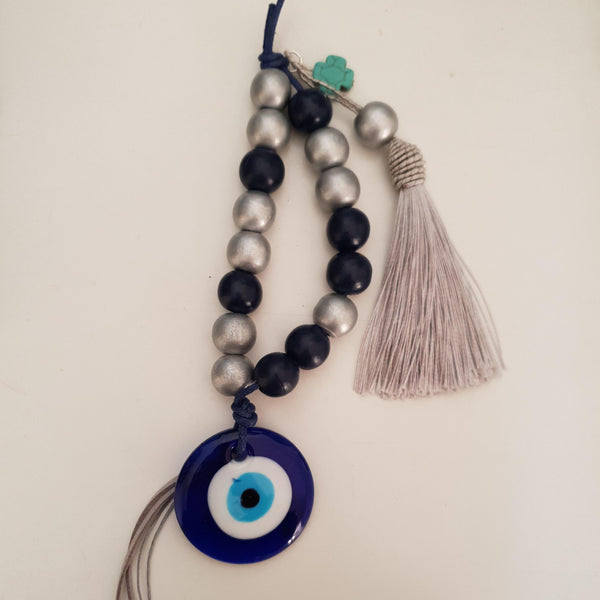 Silver and blue mati wall hanging with silver tassel and turquise cross