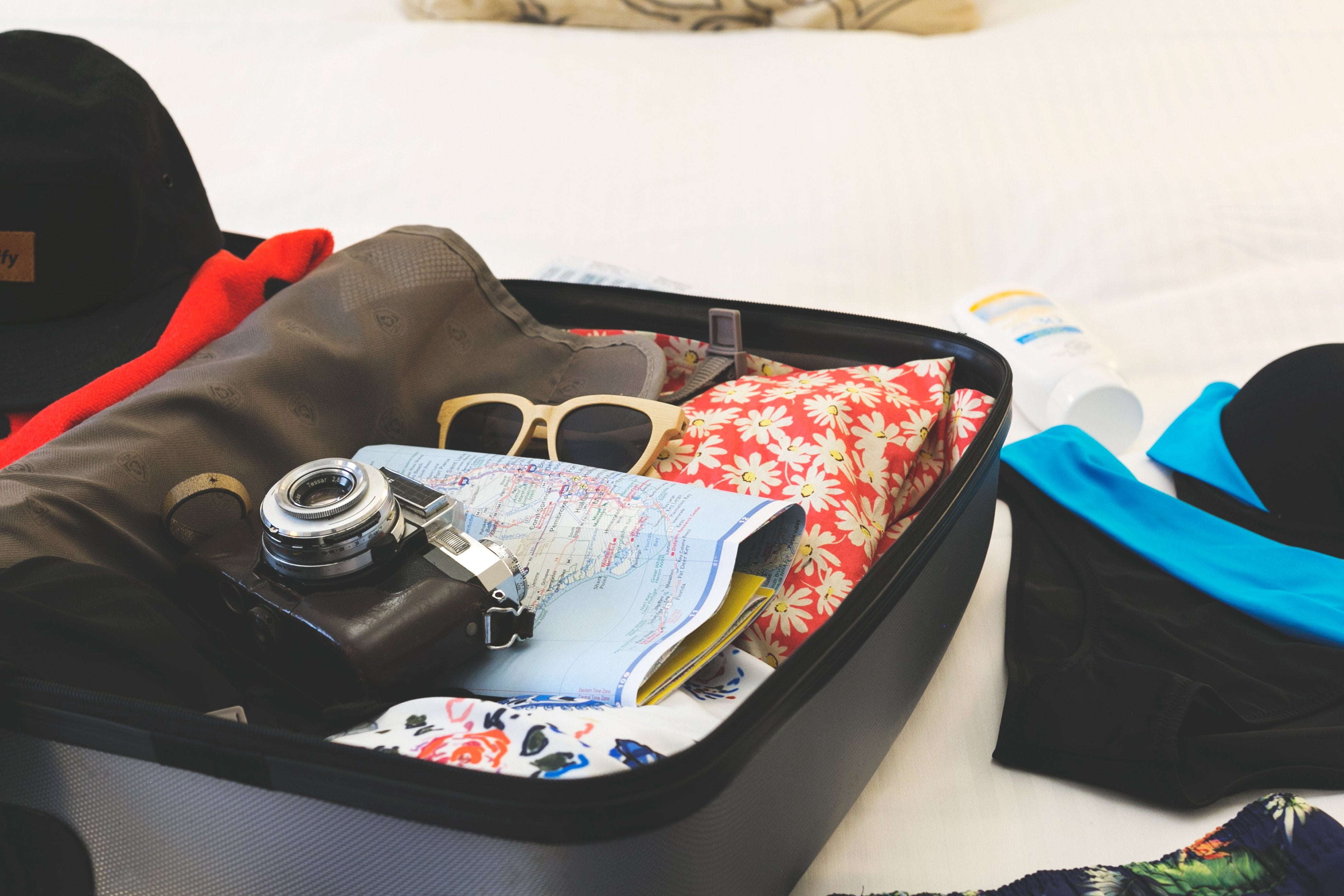 Image showing a suitcase with clothes packed for vacation