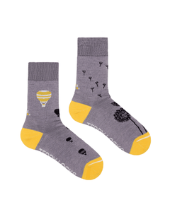 Light purple eco friendly socks for women. Made from Repreve recycled polyester. Yellow and purple sustainable socks.