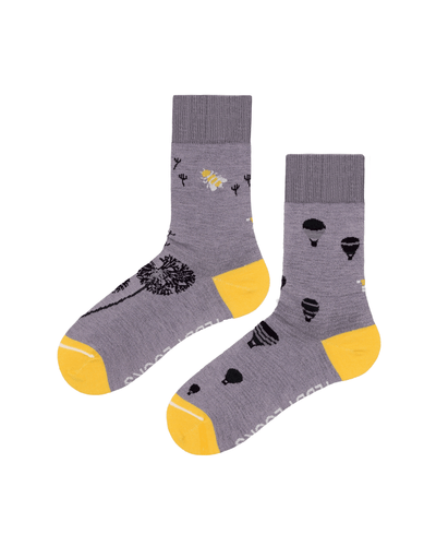 Light purple women's sustainable ecofriendly socks with balloon and bee designs. Yellow toe and heel socks with dark purple patterns. Made from recycled plastic bottles in the USA.
