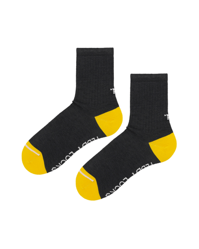 Ecofriendly charcoal ribbed crew socks. Yellow and black socks made in the USA.