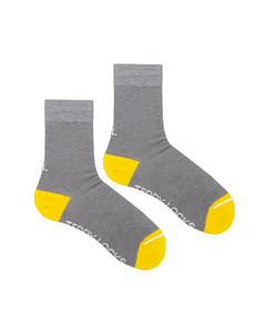 Grey crew socks with yellow toes made in the USA.