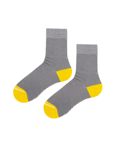 Ecofriendly grey crew socks with yellow toe and heel.