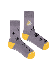Colorful sustainable socks with seastar and ship designs.