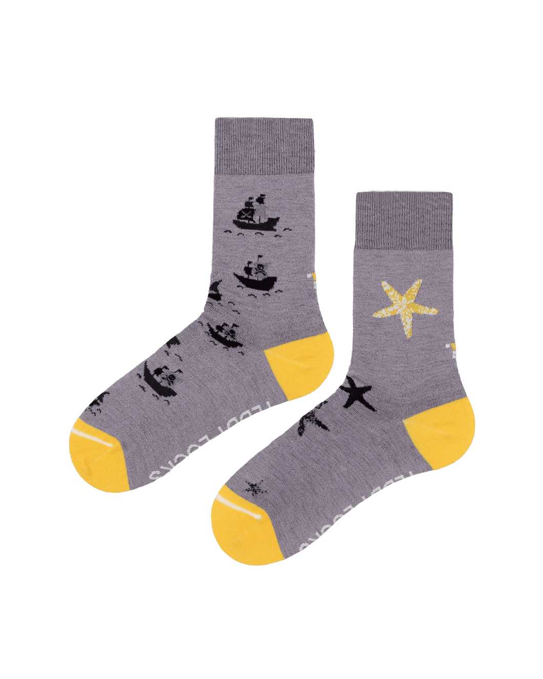 Teddy Locks sustainable socks. Light purple mismatched socks with yellow toes.