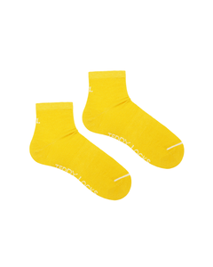 Colorful sustainable socks. Yellow quarter length socks made in the USA