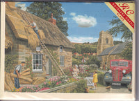 Thatching The Cottage Greetings Card - Trevor Mitchell