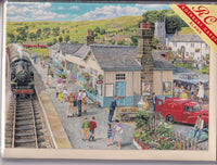 The Village Train Station Greetings Card - Trevor Mitchell