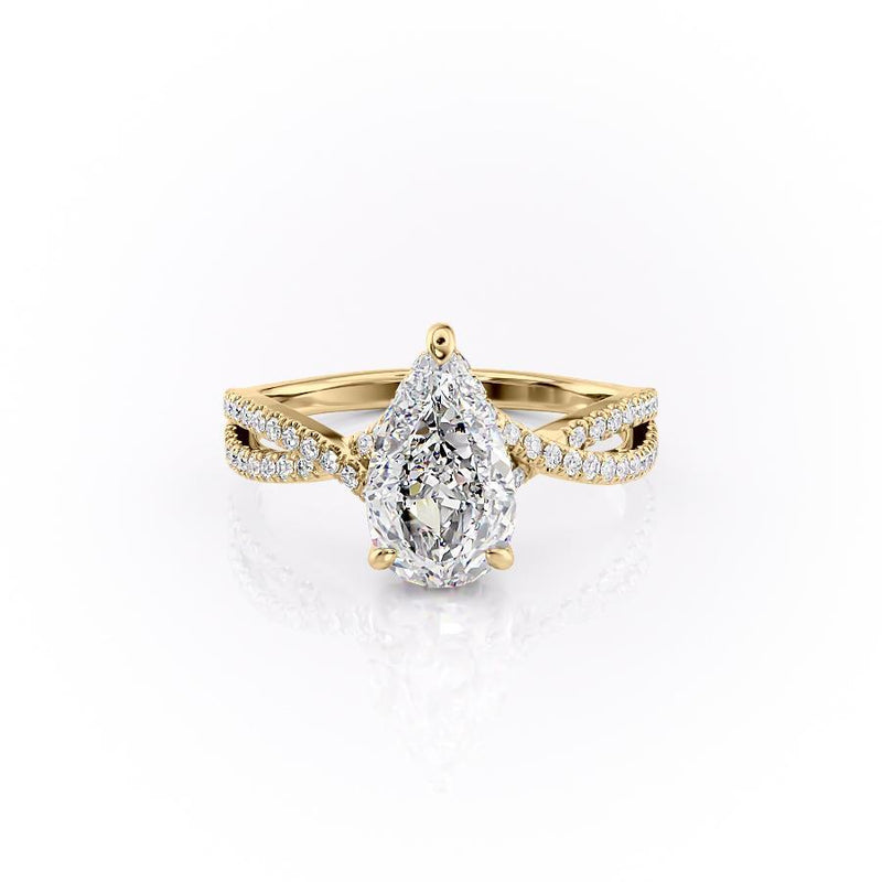 Pear Cut Moissanite Ring With Twisted Stone Set Shoulders