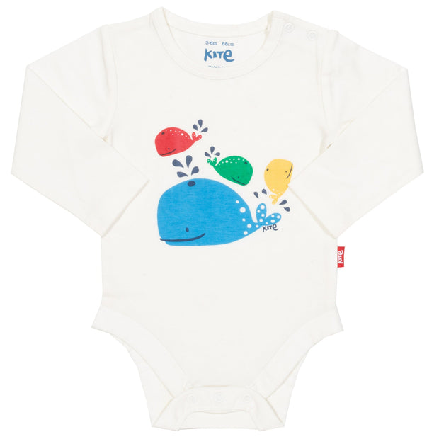 Baby in rainbow whale bodysuit