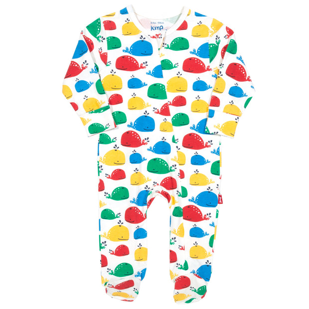 Baby in rainbow whale sleepsuit