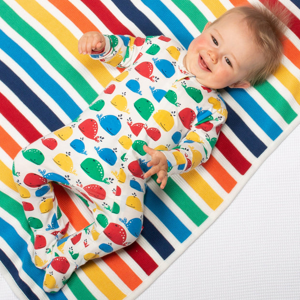 Baby in rainbow knit blanket