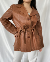 Load image into Gallery viewer, Woman wearing a second-hand belted leather jacket from Thrifted-Vintage.com