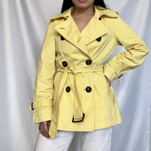 Load image into Gallery viewer, This is a Max Mara Vintage Trenchcoat in the colour Pastel Yellow. It is available on thrifted-vintage.com